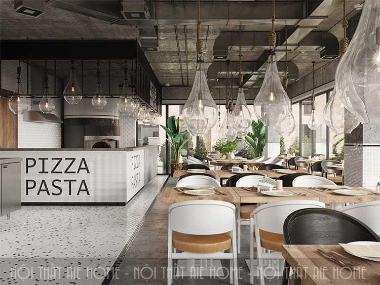 thiết kế nhà hàng ăn uống giữa hệ thống đèn chiều sáng và cây cảnh